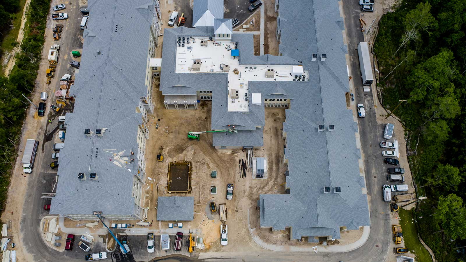 Aerial View Of Secure Outdoor Courtyard And Swimming Pool Construction At Our Brand New Independent Living, Assisted Living And Memory Care Community In Little River, SC